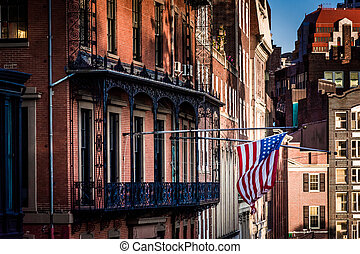 American flag hanging from a building in Boston, Massachusetts.