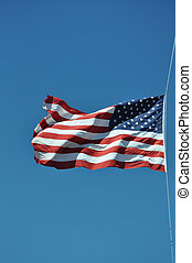 American flag in a blue sky
