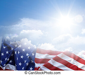 American flag in blue sky