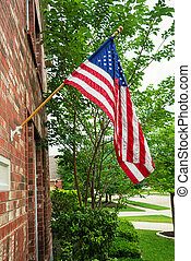 American flag in front of a home