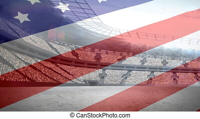 American flag in front of a stadium