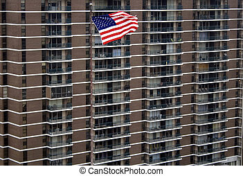American Flag in front of Apartment Building