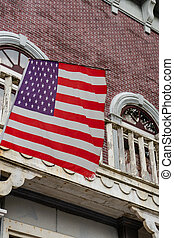 American flag in front of old style building