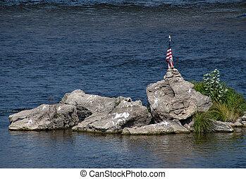 American flag in rocks