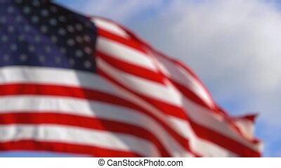 American Flag in Slow Motion. BLURRED BACKDROP