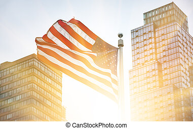 American flag in the rays of the rising sun - View of...