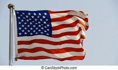 American flag is fluttering in wind.