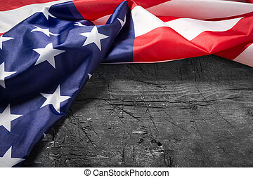 American flag lying on old wooden board