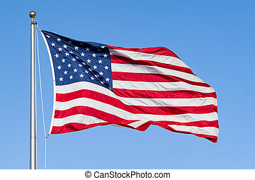 American Flag on a blue sky background; Close Up for Memorial Day or 4th of July