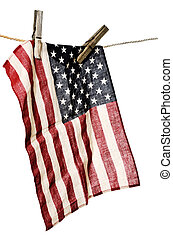 american flag on a clothesline with wooden clothespins