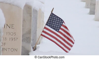 American flag on a grave stone in Jefferson Barracks National Cemetery in Missouri
