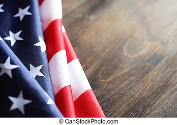 American flag on a wooden texture table and space for text