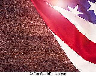 American Flag on a wooden, vintage surface