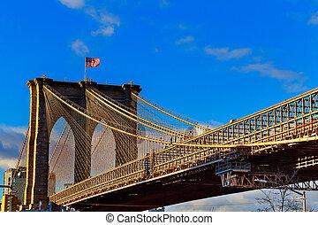 Brooklyn bridge with cloudy blue sky, New York