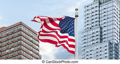 American flag on building background - View of American flag...