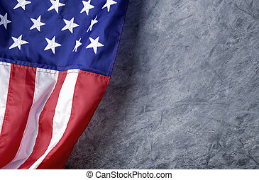 American flag on cement background with copy space