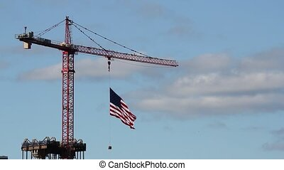 American Flag on Construction Crane - American Flag Flying...