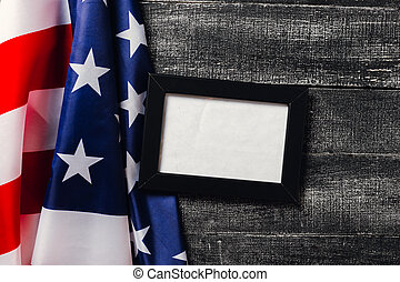 American flag on dark background. Flag Veterans Day Concept with place for your text