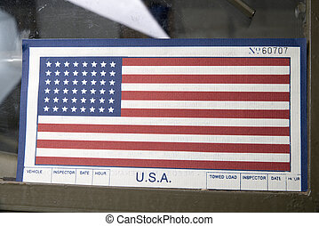 American flag on the windshield of a military vehicle
