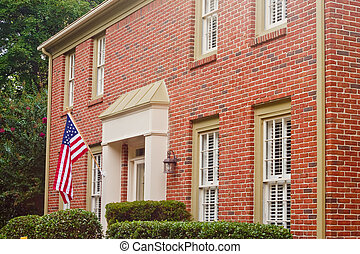 American Flag on Traditional Brick House