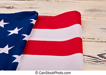 American flag on vintage wooden background.