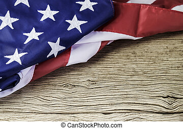 American flag on wood background with copy space