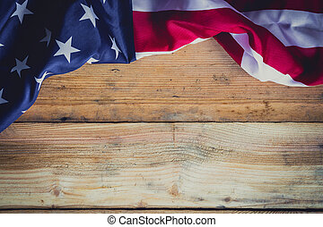 American flag on wooden background with copy space.