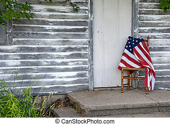 American flag on wooden chair