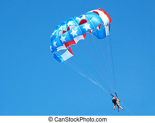 American flag parasail - Couple flying in american flag ...