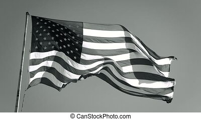 American Flag Slow motion Waving, Black and White. Black and white American USA flag waves in the breeze, bottom view. American flag flying in the wind, BW video. Monochrome American Flag Flies