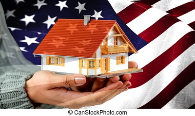 American flag video - Woman holding little toy house aganst ...