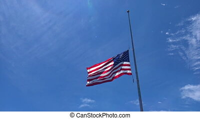 American Flag Waving against Blue Sky