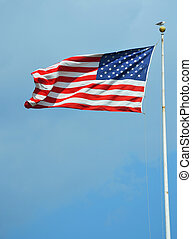 American flag waving in a sky