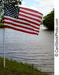 American Flag Waving in front of River