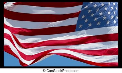American flag waving in the wind on blue sky, US flag slow ...