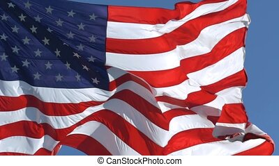 American Flag Waving In United States Of America. American Flag Slow motion Waving. Close up of American flag waving. Majestic american flag in the wind. SUPER SLOW MOTION, CLOSE UP