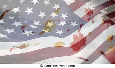 American flag waving with leaves falling