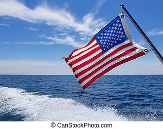 American flag with boat wake