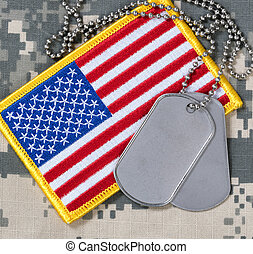 American flag with dog tags on camouflage