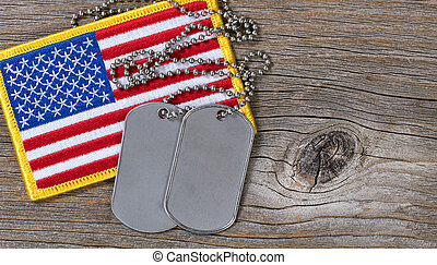 American flag with dog tags on rustic wood