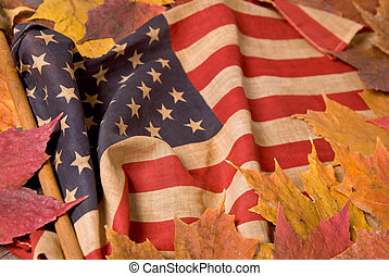 American flag with fall leaves - detail of a vintage...