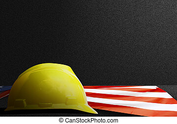 American flag with hardhat on black background