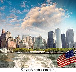 American flag with New York skykine on background