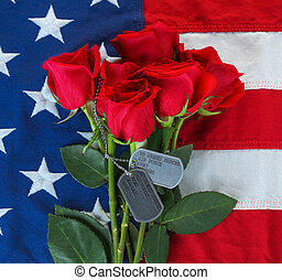American flag with roses and military dog tags