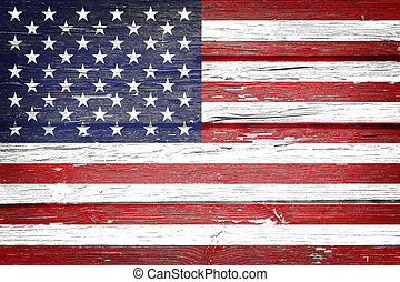 American flag with vintage look on wooden background