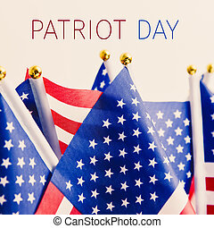 American flags and text patriot day