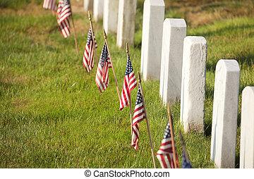 American flags near gravestones at Arlington National...