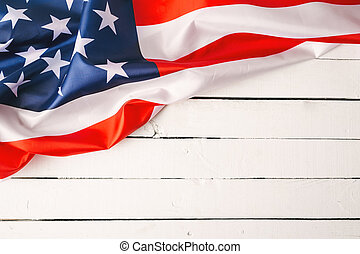 American flags on old wood for background