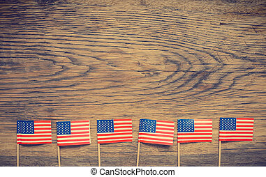 American flags on wood