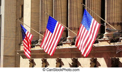 American Flags on wall of building